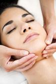 Pretty young woman having a massage — Stock Photo