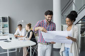 Young people in the office — Stock Photo