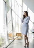 Young woman in the office — Stock Photo