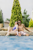 Young couple by the pool — Stock fotografie