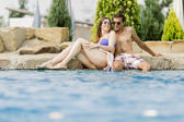 Young couple by the pool — Stock Photo