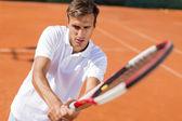 Man playing tennis — Stock Photo