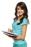 Kvinna att göra anteckningar i anteckningsboken — Stockfoto
