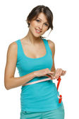 Woman measuring her waist with a measuring tape — Stock Photo