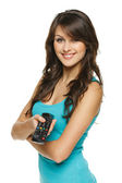 Woman holding TV remote control — Stockfoto