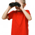 Six years boy looking away through the binoculars — Stock Photo