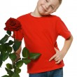 Six years old boy holding the red rose — Stock Photo