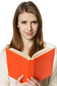 Woman holding a book — Stockfoto