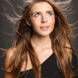 Young woman with hair flying — Stock Photo