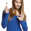 Woman holding key and making OK gesture — Stock Photo