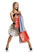 Happy female with shopping bags — Stock Photo