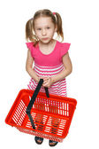 Little girl in ful length holding empty shopping basket — Stock Photo
