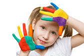 Little girl with painted fingers — Stock Photo