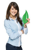 Business woman holding eco leaf — Stock Photo