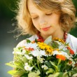 Girl with bunch of wildflowers - Stock Photo