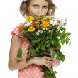Girl holding bunch of wildflowers - Stock Photo