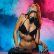 Stock Photo: Excited DJ girl on decks on party