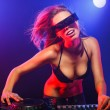 Excited DJ girl on decks on the party — Stok fotoğraf
