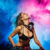 Excited DJ girl on decks on the party — Zdjęcie stockowe