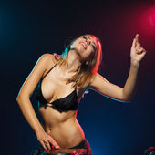 Excited DJ girl on decks on the party — Stock Photo