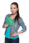 Casual denim teen female holding green leaf — Stock Photo