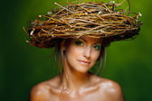 Closeup of beautiful young woman with wicker crown — Stock Photo