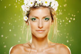 Closeup of beautiful female with white flower wreath — Stock Photo
