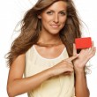 Stock Photo: Womin yellow dress holding empty credit card