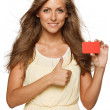 Woman holding empty credit card and showing thumb up — Stock Photo