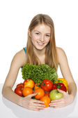 Girl embracing vegetables and fruits — Stock Photo