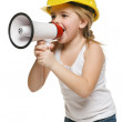 Little girl builder in yellow helmet screaming into the loudspeaker — Stock Photo #34761149