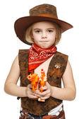 Little girl wearing cowboy costume holding guns — Stock Photo