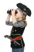 Girl wearing costume of pirate looking away through the binoculars — Stock Photo