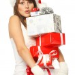 Woman with funny expression holding many gift boxes — Stock Photo #34885065