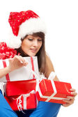 Girl unwrapping her Xmas gifts — Stock Photo