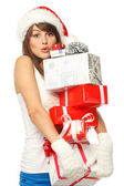 Woman with funny expression holding many gift boxes — Stock Photo