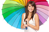 Girl standing under umbrella — Stock Photo