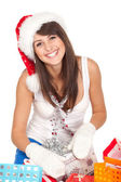 Woman sitting with christmas presents — Stock Photo