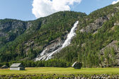 Norwegian landscape with mountain and waterfall — Stock Photo