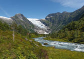 Mountain river formed by meltwater of glacier — Stockfoto