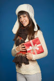 Winter woman with red gift box — Stock Photo