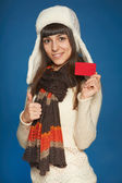 Winter woman holding credit card — Stock Photo