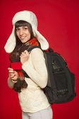Winter woman tourist holding credit card — Stock Photo