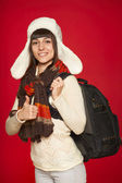 Winter woman tourist with backpack — Stock Photo