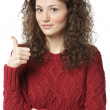 Female in sweater with folded hands showing thumb up — Stock Photo #38089175