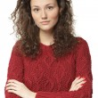 Casual woman in sweater with folded hands — Stock Photo #38089409