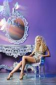 Fashion models posing in glamorous interior — Stock Photo