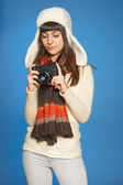 Woman photographer adjusting photo camera settings — Stock Photo