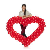 Smiling woman holding red balloon heart — Foto de Stock