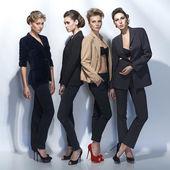 Four beautiful girls in fashion style — Stock Photo